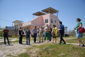 The tour group with John Williams (center) standing in front of the Frank Gehry- designed Lower Ninth Ward residence. Photo by author.