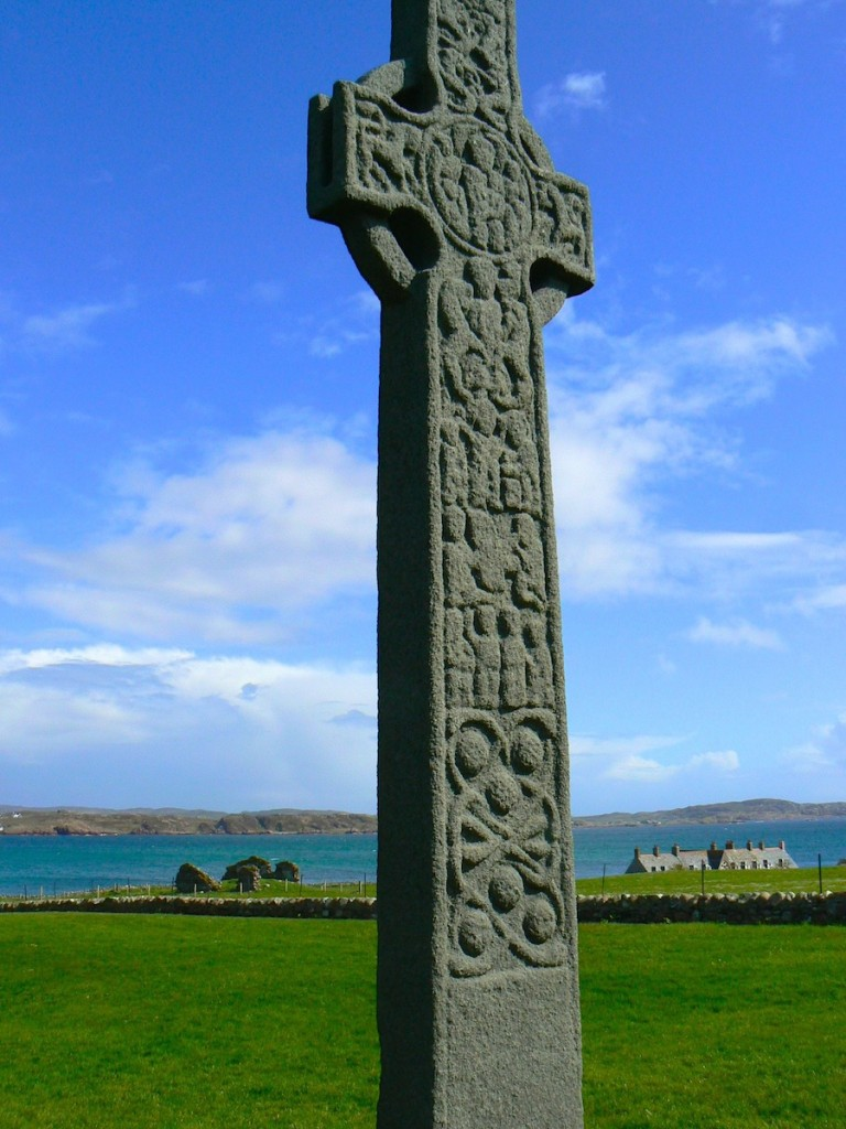 The island of Iona, in Scotland's northern Inner Hebrides, is the location where the monk Columba established a monastery in the year 563. This monastic center evolved to become an important site in Celtic Christianity. Its scriptorium produced many important documents, including the famous Book of Kells. Several Irish crosses, including St. Martin's Cross seen here, were added to the site in the 9th century.
