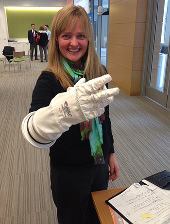 Carrie Anderson '06 tests an innovative glove designed by the public for NASA space explorations.