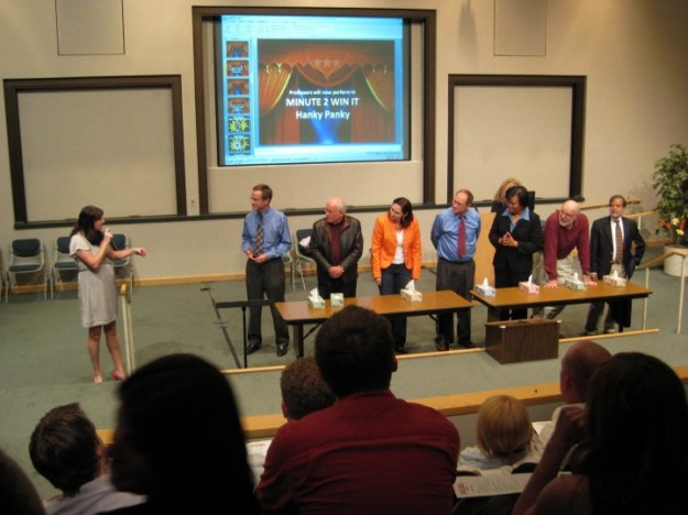 """UST MBA faculty and staff take on a """"Minute to Win It"""" challenge at the MBA Follies."""