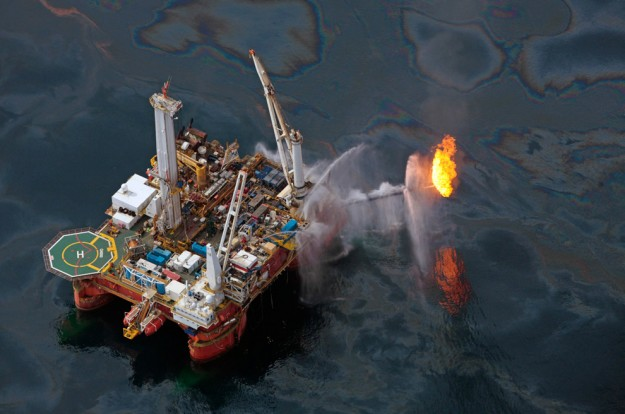 The Q4000 drilling rig operates in the Gulf of Mexico at the site of the Deepwater Horizon disaster Wednesday, June 16, 2010. (AP Photo/Dave Martin)