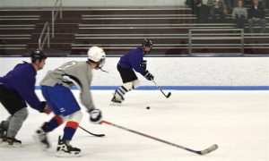 MBA hockey team (in purple) in action against the Law School team