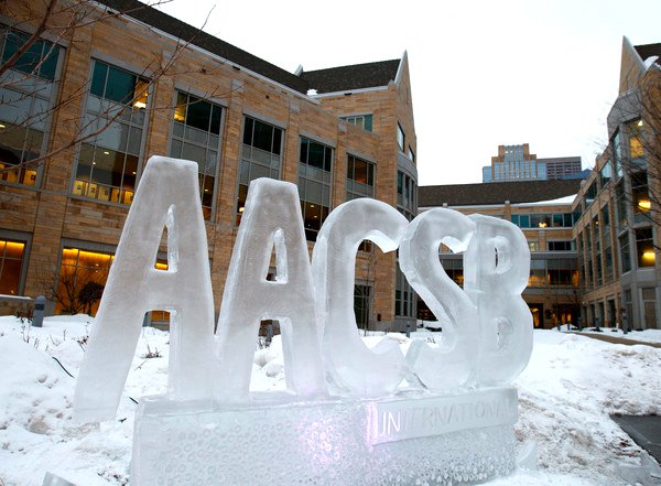 A finished AACSB logo in ice stands outside the University of St. Thomas' Minneapolis campus January 5, 2011. The ice sculpture helped announce that the Opus College of Business has earned accreditation from the Association to Advance Collegiate Schools of Business (AACSB). (Mike Ekern/University of St. Thomas)