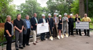 Representatives from St. Thomas, JMS Custom Homes, and the UST Real Estate Advisory Board break ground on the home in Edina.