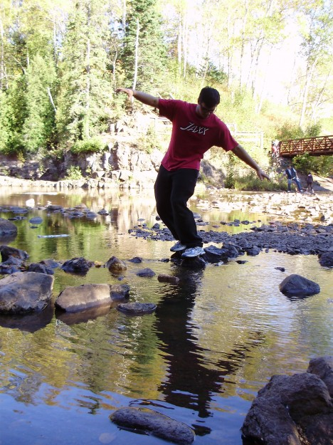 A friend jumps rock to rock at Gooseberry Falls- October 2011.