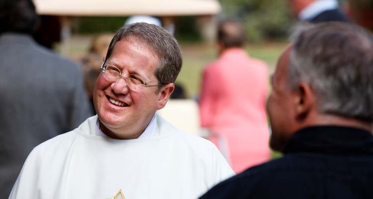Father Erich Rutten, director of campus ministry at the University of St. Thomas, talks outside following the funeral mass of Monsignor James Lavin at the Chapel of St. Thomas Aquinas on September 21, 2012.