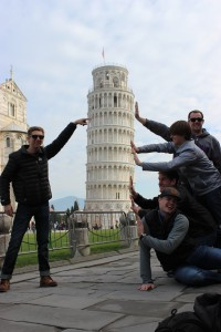 A group of us taking a classic picture at the Leaning Tower of Pisa
