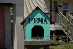 "While snapping this photo, Smitty smirked while asking me ""Do you get it?"" Of course it signifies that FEMA is in the doghouse for all Lower Ninth Residents. A visual defiance of the way the government handled their neighborhood. Photo by author."