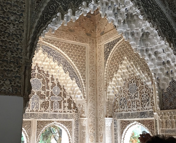 The Alhambra's Mirador, or viewing tower, was originally built with a majestic view of the landscape. A wall built by Charles V currently blocks that view but the detailed calligraphy, muqarnas, and arabesque created in stucco help make this site one of the finest examples of Islamic architecture in the world.
