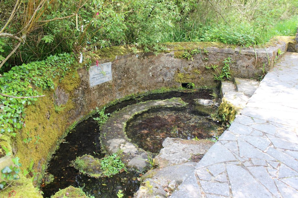 St. Brigid's Wayside Well in Tully, County Kildare. Stone steps lead down to the murky and stagnant water, and a small amount of clooties and other items point to this well still being a place of veneration. Photograph taken by author on May 30, 2016.