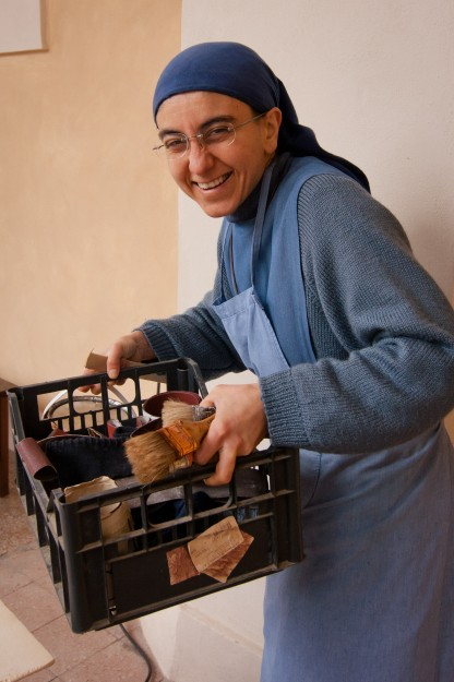 Sister Benedetta brings out the wood stain.
