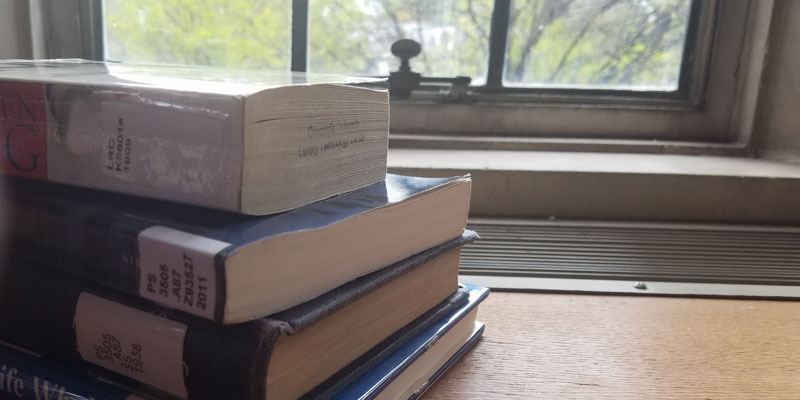 A stack of books by the window