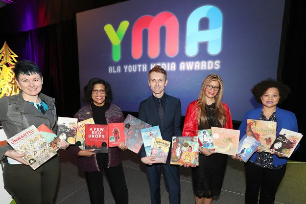 Photo of presenters holding several of the YMA award winning books