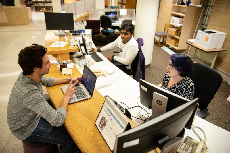 A student gets assistance at the Tech and Research Help Desk in the O'Shaughnessy Frey Library Center in St. Paul.
