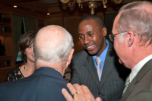 Guillaume Ndayizigiye (center), a native of Burundi, conversed with Gerald (Gerry) Rauenhorst and his son, Mark (right), at the 20th anniversary celebration of the Family Business Center, held in September 2010. The center is located on the university's Minneapolis campus. Ndayizigiye, an alum of St. Thomas' MBA program, is helping to develop a Family Business Center at Great Lakes University in Burundi. / Photo by Mark Jensen, UST Photo Services.