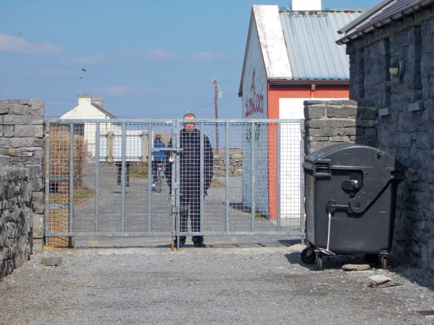"""Inis Mór: One of my favorite pictures.  We managed to get stuck on the other side of the fence from our gracious (in every sense of the word- there's nothing he didn't go out of his way to provide for our comfort) host, Fr. Shane, """"the Yank priest."""""""