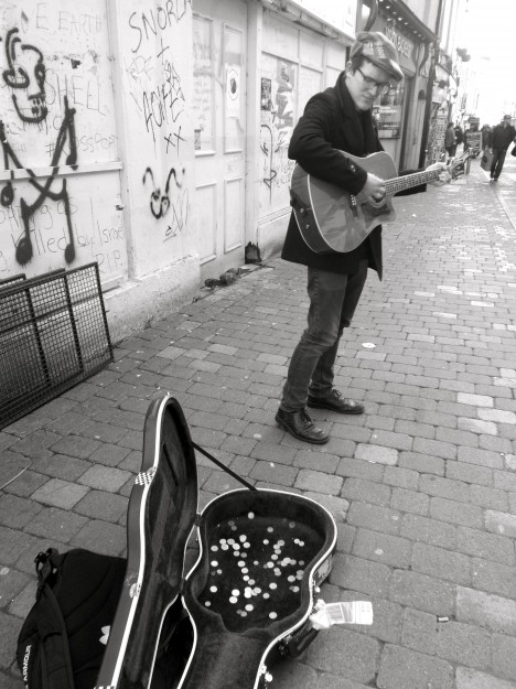 """We ran into a friend of a friend for the second time on this trip, """"busking"""" in the shopping district of Galway City.  One of my favorite things about Europe are all the talented musicians playing in the streets."""