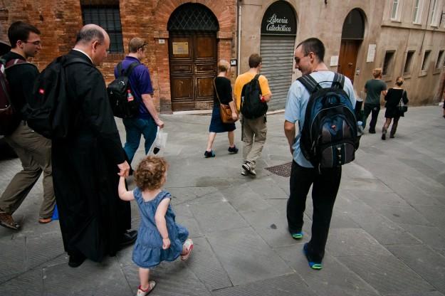 Fr. Carola and Annie Junker walk hand in hand through Siena.