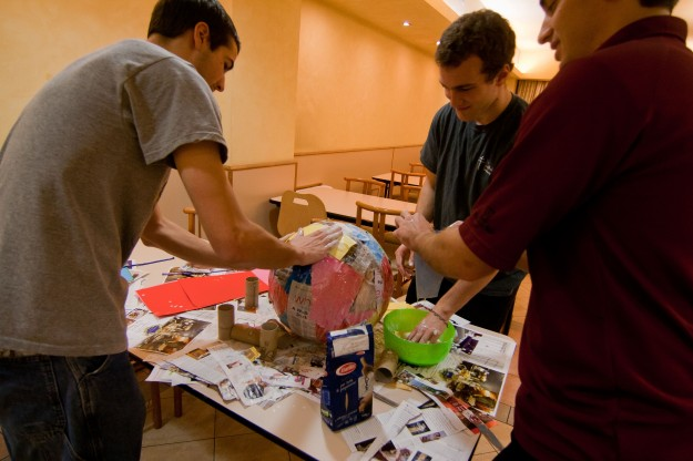 Dan Foley, Kyle Laylan, and Andrew Dieter work on the piñata.