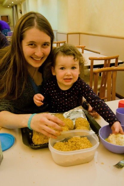 Annie Junker wanted to help, so she and Hannah Polsky rolled the ice cream in corn flakes for the fried ice cream.