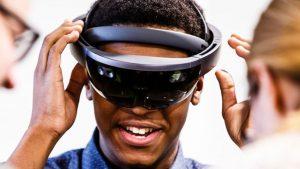 Black Male undergraduate student wearing a virtual reality headset