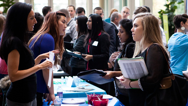 Students engage with employers at the Career Opportunity Fair in the School of Law Schulze Grand Atrium on Friday, November 15, 2013.